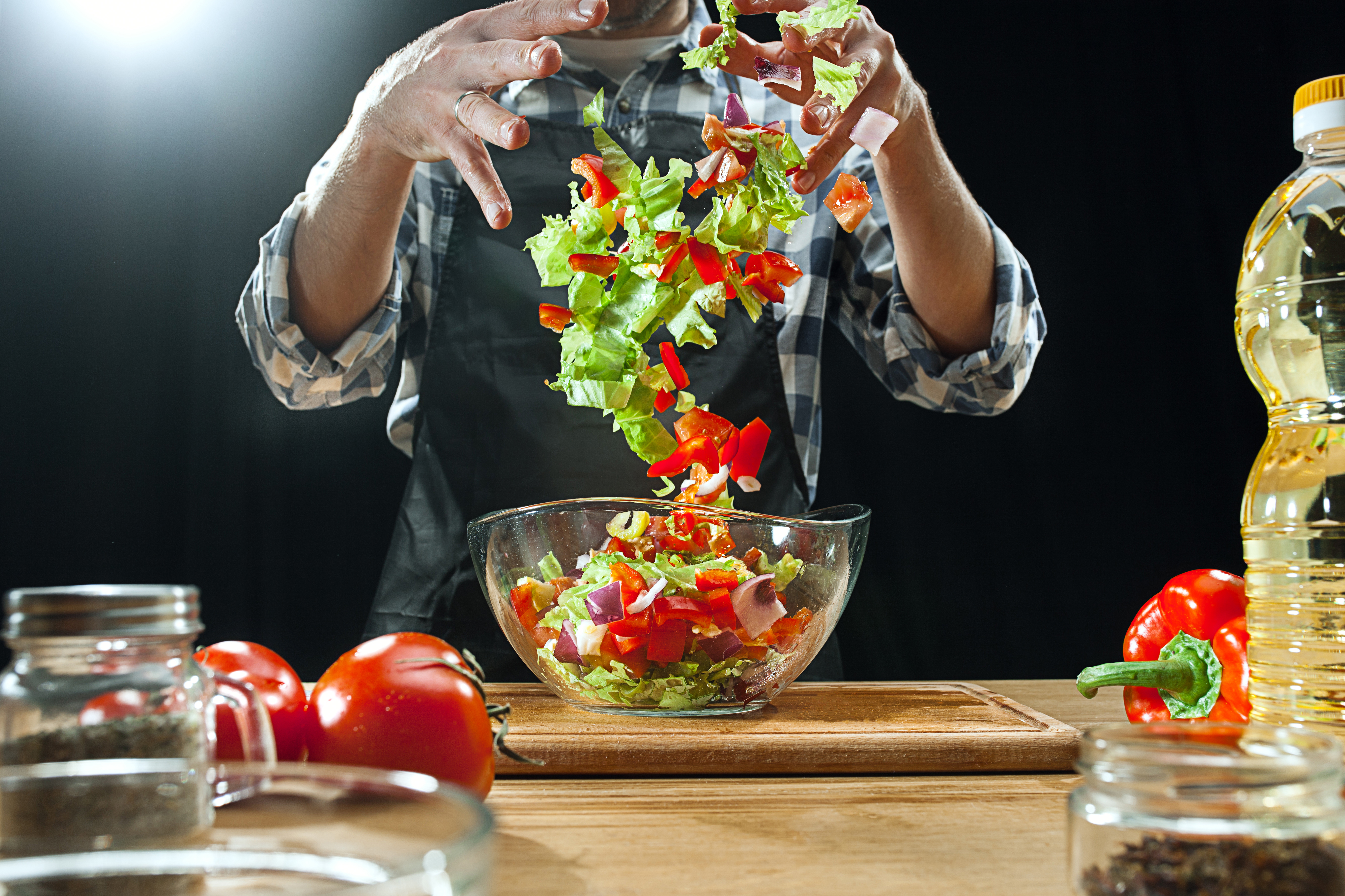 Preparing salad. Female chef cutting fresh vegetables. Cooking process. Selective focus